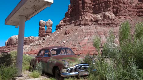 An-old-car-sits-at-am-abandoned-gas-station-along-a-rural-highway-in-Utah