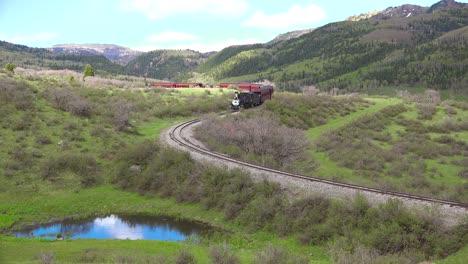The-Cumbres-and-Toltec-steam-train-moves-through-Colorado-Mounatins-near-Chama-New-Mexico