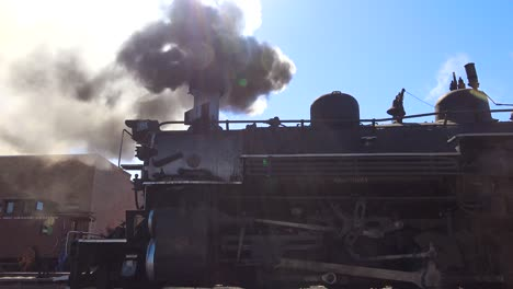 Low-angle-of-Cumbres-and-Toltec-steam-train-leaving-station