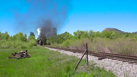 Low-of-the-Cumbres-and-Toltec-steam-train-moving-through-Colorado-mountains-near-Chama-New-Mexico