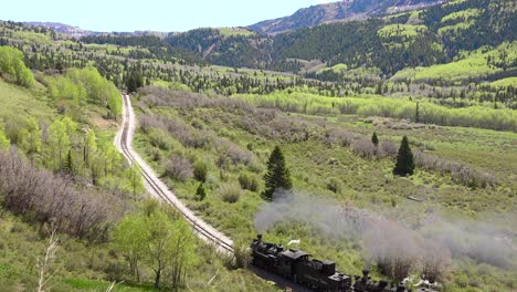 Low-of-the-Cumbres-and-Toltec-steam-train-moving-through-Colorado-mountains-near-Chama-New-Mexico-2