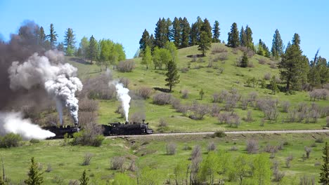 Low-of-the-Cumbres-and-Toltec-steam-train-moving-through-Colorado-mountains-near-Chama-New-Mexico-3