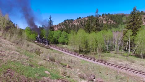 Cumbres-and-Toltec-steam-train-moving-through-Colorado-mountains-near-Chama-New-Mexico