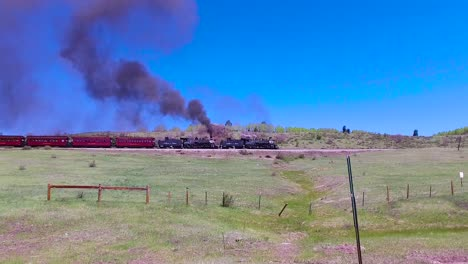 Traveling-shot-of-Cumbres-and-Toltec-steam-train-moving-through-Colorado-mountains-near-Chama-New-Mexico-1