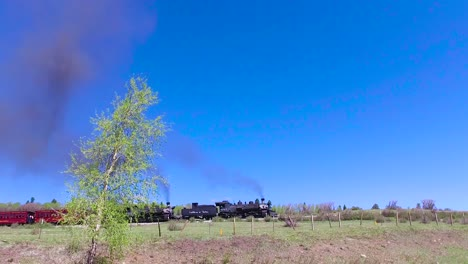 Traveling-shot-of-Cumbres-and-Toltec-steam-train-moving-through-Colorado-mountains-near-Chama-New-Mexico-3