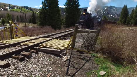 Low-angle-rise-up-of-Cumbres-and-Toltec-steam-train-moving-through-Colorado-mounatins-near-Chama-New-Mexico
