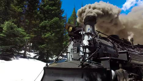 Low-angle-rise-up-of-Cumbres-and-Toltec-steam-train-moving-through-Colorado-mounatins-near-Chama-New-Mexico-1