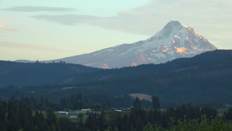 Sunset-light-on-Mt-Hood-near-Hood-River-Oregon-with-farms-and-fields-foreground-1