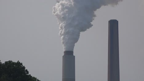 Industrial-smokestacks-belch-pollution-into-the-atmosphere-releasing-greenhouse-gas-and-contributing-to-global-warming