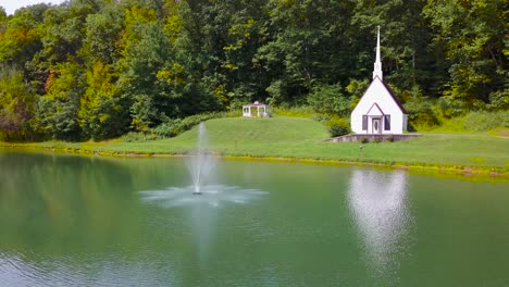 Aerial-over-a-romantic-and-beautiful-small-church-in-the-American-wilderness-West-Virginia-4