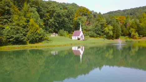 Aerial-over-a-romantic-and-beautiful-small-church-in-the-American-wilderness-West-Virginia-5