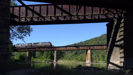 A-coal-train-travels-over-a-bridge-loaded-with-cargo-in-West-Virginia