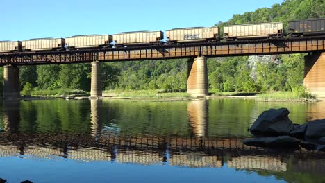 A-coal-train-travels-over-a-bridge-loaded-with-cargo-in-West-Virginia-1