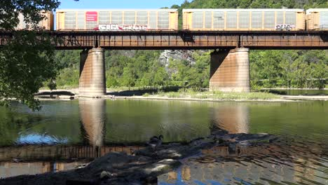 A-freight-train-travels-over-a-bridge-loaded-with-cargo-in-West-Virginia-2