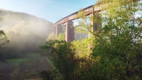 Beautiful-aerial-over-a-steel-railway-trestle-in-the-fog-in-West-Virginia-Appalachian-mountains