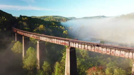 Beautiful-aerial-over-a-steel-railway-trestle-in-the-fog-in-West-Virginia-Appalachian-mountains-1