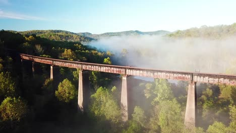 Beautiful-aerial-over-a-steel-railway-trestle-in-the-fog-in-West-Virginia-Appalachian-mountains-2