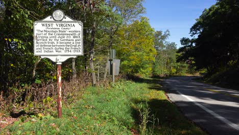 An-antique-historical-road-sign-welcomes-visitors-to-West-Virginia