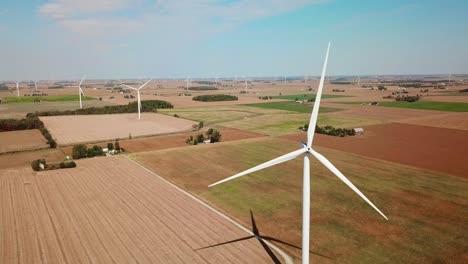 Aerial-through-a-wind-turbine-producing-alternative-electricity-in-rural-Michigan