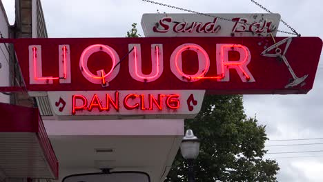 Establishing-shot-of-a-downtown-small-town-dive-bar-and-nightclub-serving-liquor-and-dancing