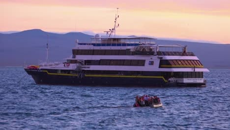 Tourists-return-to-a-research-boat-in-the-Galapagos-Islands