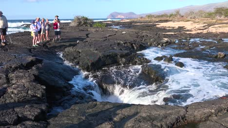 Water-flows-into-a-blowhole-on-the-Galapagos-Islands