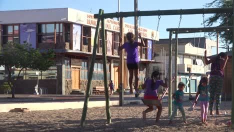 Children-play-on-a-playground-in-Puerto-Baquerizo-Moreno-harbor-the-capital-city-of-the-Galapagos-Islands-Ecuador