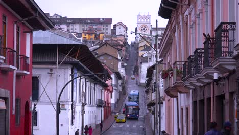 Busses-and-cars-travel-on-the-old-streets-of-Quito-Ecuador