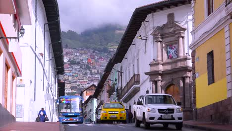 Busses-and-cars-travel-on-the-old-streets-of-Quito-Ecuador-1
