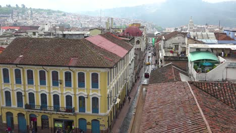 Establishing-shot-across-the-rooftops-of-Quito-Ecuador-with-busy-streets-and-pedestrians