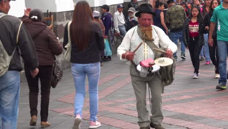 A-one-man-band-musician-walks-the-streets-of-Quito-Ecuador-making-music