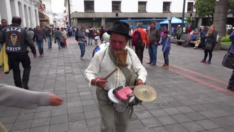 A-one-man-band-musician-walks-the-streets-of-Quito-Ecuador-making-music-1