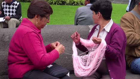 Two-women-knit-and-sew-in-the-park-in-Quito-Ecuador