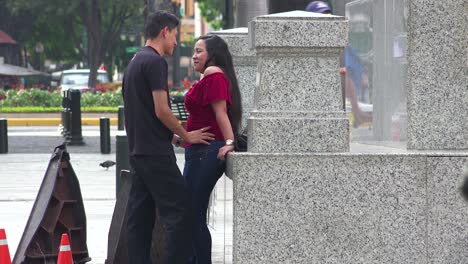 A-man-tries-to-steal-a-kiss-from-a-young-lady-on-the-streets-of-Guayaquil-Ecuador