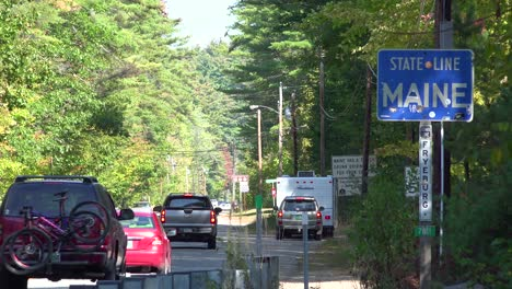 Cars-cross-the-border-into-Maine-with-a-sign-greeting-visitors