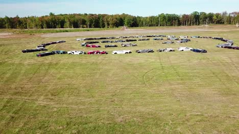 An-vista-aérea-over-a-circle-of-crushed-cars-in-a-large-field-near-Portland-Maine