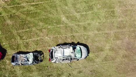 An-aerial-over-a-circle-of-crushed-cars-in-a-large-field-near-Portland-Maine-1