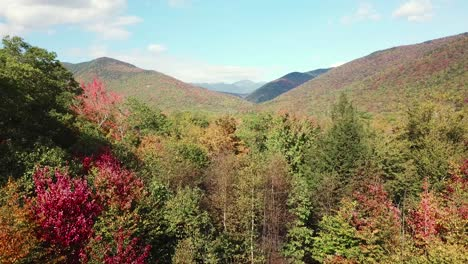 An-aerial-over-New-Hampshire-forests-and-the-White-Mountains-with-Mt-Washington-distant-1