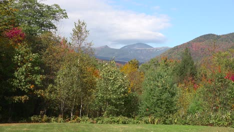 An-establishing-shot-of-rural-New-Hampshire-forests-and-the-White-Mountains-with-Mt-Washington-distant