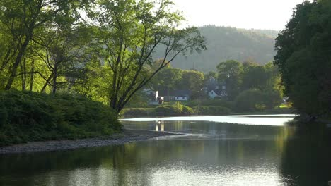 A-quaint-rural-scene-beside-a-lake-or-river-in-New-England