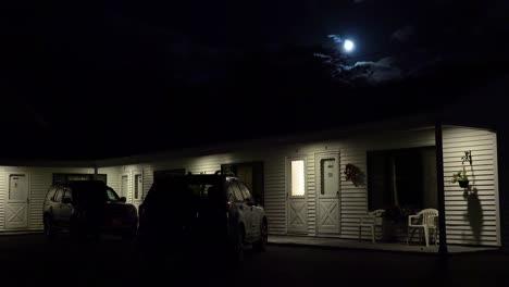 Establishing-shot-of-a-roadside-motel-under-a-full-moon-at-night