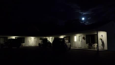Establishing-shot-of-a-roadside-motel-under-a-full-moon-at-night-1