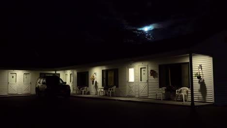 Establishing-shot-of-a-roadside-motel-under-a-full-moon-at-night-2