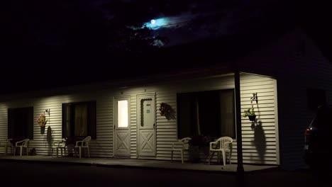 Establishing-shot-of-a-roadside-motel-under-a-full-moon-at-night-4