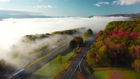Beautiful-aerial-over-a-highway-through-the-fog-in-fall-in-New-England