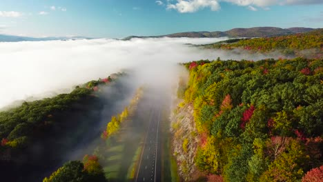 Beautiful-vista-aérea-over-a-highway-through-the-fog-in-fall-in-New-England-1