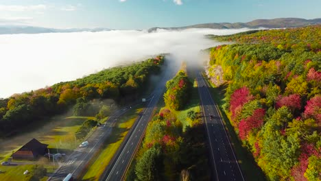 Beautiful-aerial-over-a-highway-through-the-fog-in-fall-in-New-England-2