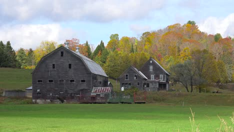 Time-lapse-behind-a-pretty-old-barn-and-farmhouse-in-Vermont