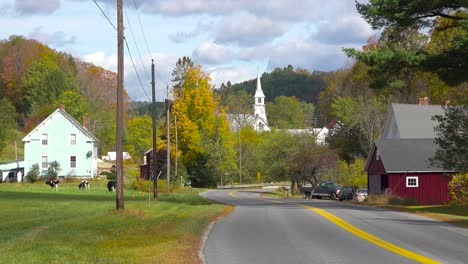 A-charming-small-village-scene-in-Vermont-with-church-farms-house-and-cows