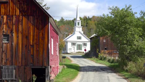 A-charming-small-village-scene-in-Vermont-with-church-road-and-farm